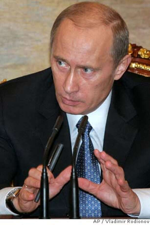 Russian President Vladimir Putin speaks during a meeting in the Moscow Kremlin on Monday, March 19, 2007. A methane gas explosion ripped through a Siberian coal mine Monday killing dozens among nearly 200 working underground in one of the deadliest mining accidents in Russia in the past decade. Putin ordered Emergency Situations Minister Sergei Shoigu to travel to the area, Russian news agencies reported. (AP Photo/RIA Novosti, Presidential Press Service, Vladimir Rodionov) Photo: VLADIMIR RODIONOV