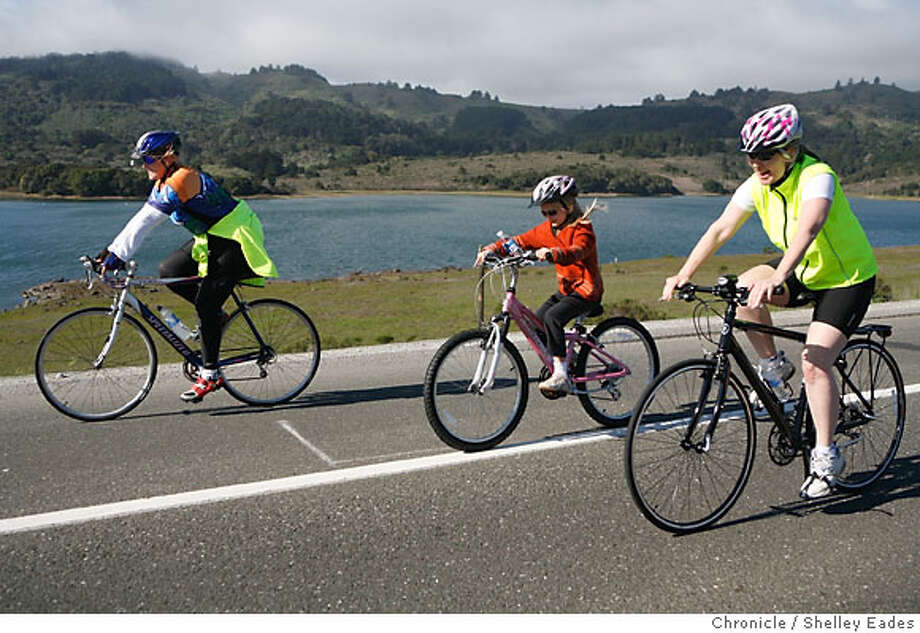 Left to right, Krista Rodeen, Libby Ross, 8, and mom Pam Ross of Redwood City, bike along Canada Road near Crystal Springs Reservoir. Every Sunday, the San Mateo County Parks and Recreation closes a portion of Canada Road from Highway 92 to Edgewood road giving people the opportunity to hike, bike, skate, jog, walk and enjoy the view, traffic free, for about 3.8 miles. Shelley Eades/The Chronicle Photo: Shelley Eades