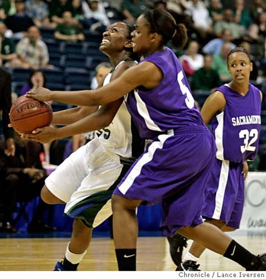 CATHEDRAL18_11461.JPG  Sacred Heart's #35 Jazmine Jackson (cq) drives past Sacramento's 35 Kashay Boyd in first half action. NorCal Girls Div 111 Championship. Sacred Heart Cathedral Vs. Sacramento. March 17, 2007. STOCKTON, CA By Lance Iversen/The Chronicle MANDATORY CREDIT PHOTOG AND SAN FRANCISCO CHRONICLE/NO SALES MAGS OUT Photo: By Lance Iversen