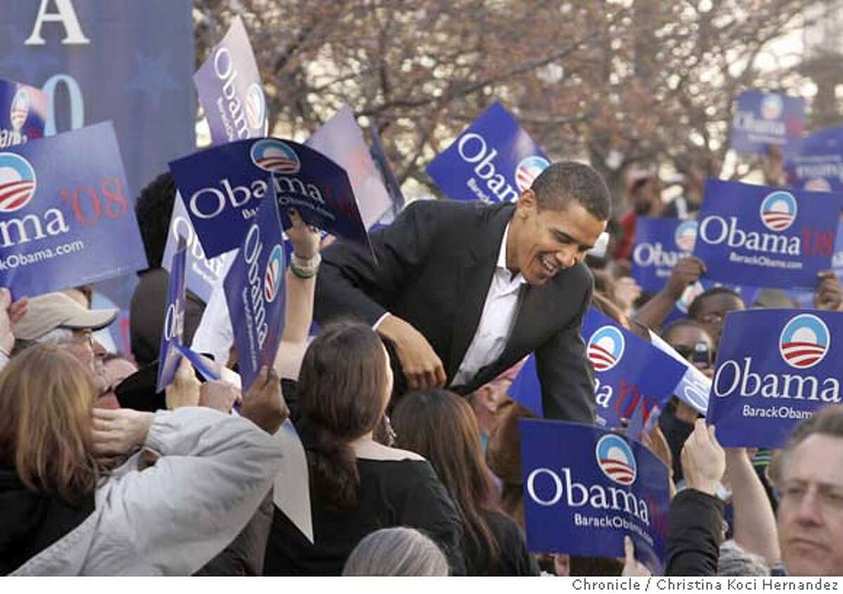 Obama greets his supporters as he walks down the risers, through the crowd to the stage.Presidential candidate, Barack Obama, rallies in Oakland's City Center.(Christina Koci Hernandez/The Chronicle)