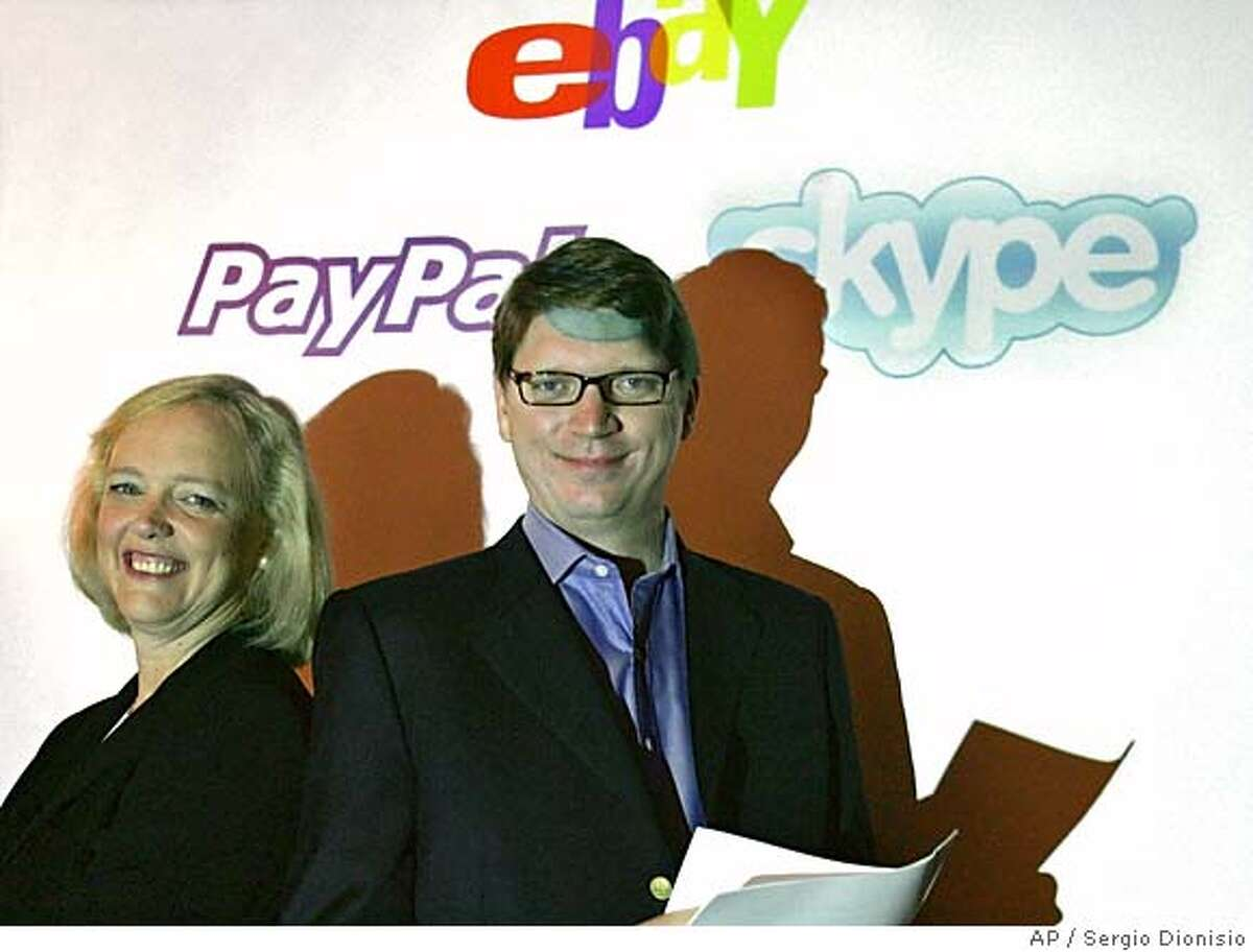 In this photo released by eBay, President and Chief Executive Officer of eBay, Meg Whitman, left, stands with Niklas Zennstrom, CEO and Co founder of Skype, the global Internet communications company, in central London, Monday Sept, 12, 2005. EBay Inc. said Monday it will acquire Internet communications company Skype Technologies SA for about US$2.6 billion in up-front cash and eBay stock. (AP Photos / Sergio Dionisio, eBay) PHOTO RELEASED BY EBAY