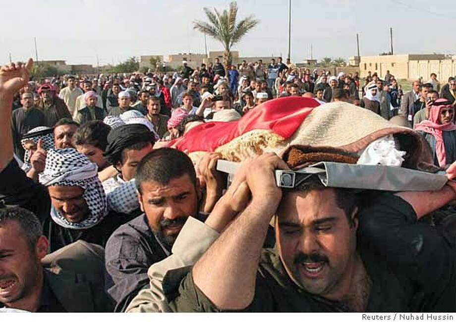 Men carry the body of Iraq's former vice president Taha Yassin Ramadan during a funeral in Awja, near Tikrit, 175 km (110 miles) north of Baghdad, March 20, 2007. Saddam Hussein's former vice president Ramadan was hanged for crimes against humanity early on Tuesday, the fourth anniversary of the U.S.-led invasion that toppled Saddam Hussein from power. REUTERS/Nuhad Hussin (IRAQ) 0 Photo: STR