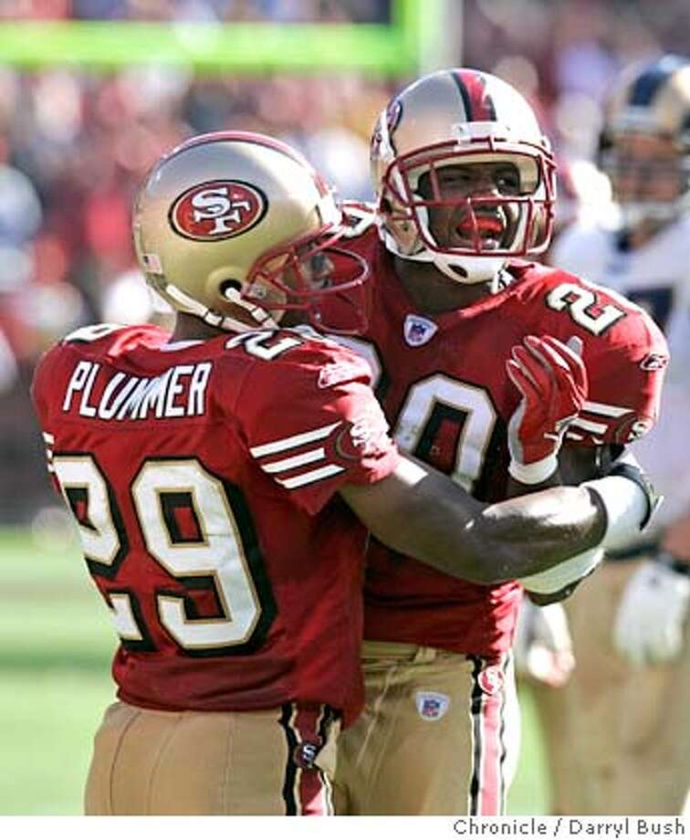 49ers_925_db.jpg  San Francisco 49ers Safety Mike Adams (20) celebrates with 49ers Ahmed Plummer (29) after a key interception late in the game vs. St. Louis Rams in the 4th qtr. at Monster Park (formerly Candlestick Park).  Event on 9/11/05 in San Francisco.  Darryl Bush / The Chronicle MANDATORY CREDIT FOR PHOTOG AND SF CHRONICLE/ -MAGS OUT Photo: Darryl Bush