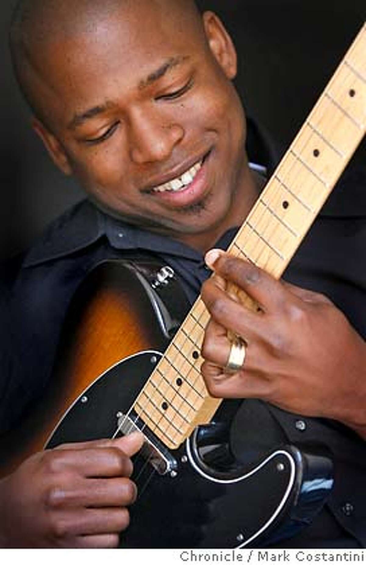 Profile of guitarist Terrence Brewer, who will perform at Yoshi's on 3/20. He's pictured her at his home in Alameda. photo taken on 3/14/07 ( Mark Costantini / The Chronicle ) Terrence Brewer (cq) MANDATORY CREDIT FOR PHOTOGRAPHER AND SAN FRANCISCO CHRONICLE/NO SALES-MAGS OUT
