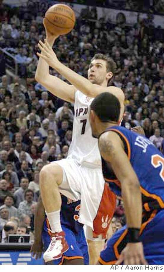 Toronto Raptors Andrea Bargnani,of Italy left, drives to the basket as New York Knicks Jared Jeffries looks on during second half NBA action in Toronto, Canada Wednesday, March 14, 2007. The Raptors beat the Knicks 104-94. (AP PHOTO/CP,Aaron Harris) CANADA Photo: Aaron Harris