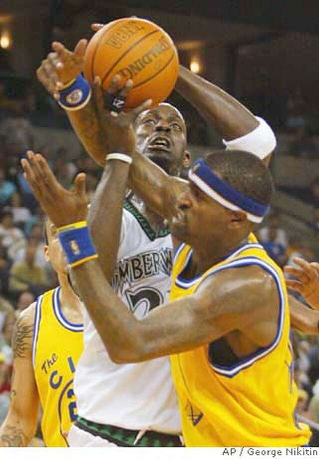 Minnesota Timberwolves' Kevin Garnett goes up as Golden State Warriors Stephen Jackson, right, guards during the first half of an NBA basketball game, Friday, March 16, 2007 in Oakland, Calif. (AP Photo/George Nikitin) Photo: George Nikitin