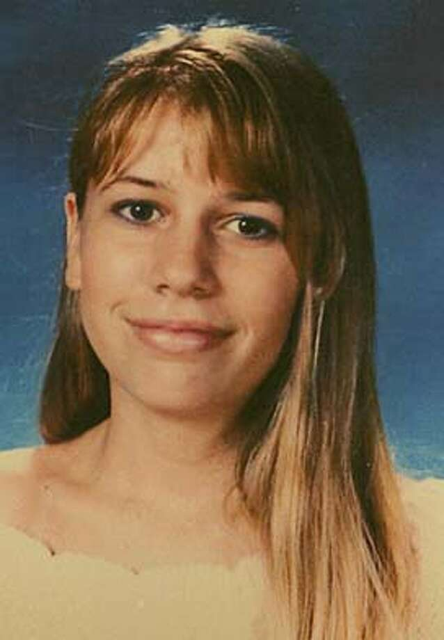 COPY PHOTO, COPY PHOTO  Of Jessica McHenry .  Alameda County sheriff's investigators announce a new lede in the unsolved murder of Jessica McHenry, 14, whose burning body was found along a rural road near Livermore in 1991. A poster-sized picture of Jessica will be displayed, as members of her family gather around it and the Carole Sund/Carrington Memorial Reward Foundation announces a $5,000 reward for information leading to an arrest and conviction. 4/27/04 in San Leandro,CA.  Kurt Rogers/The Chronicle Photo: Kurt Rogers