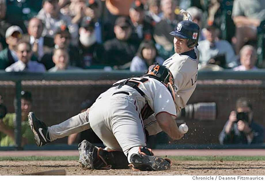 Mike Metheny loses the ball and cannot make the play as Mark Loretta scores the winning run on a hit by Brian Giles in the 10th inning. San Diego Padres beat the San Francisco Giants 5-4 at SBC Park.  Deanne Fitzmaurice / San Francisco Chronicle Photo: Deanne Fitzmaurice
