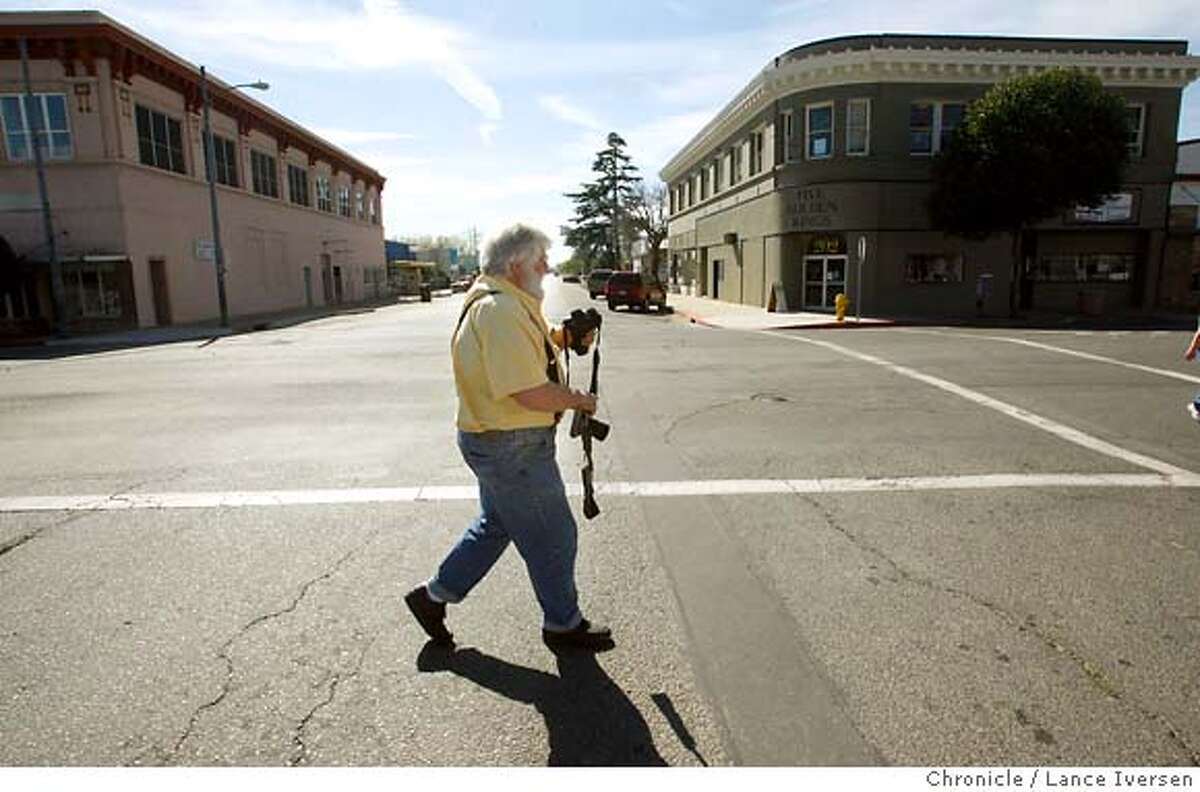 CREWS_9809.JPG Tim Crews, Publisher and Editor of The Sacramento Valley Mirror in Willows walks from his downtown office to his next assignment at the Glenn County Jail, just hour before going to press. Crews is pretty much a one-man newspaper operation in Willows. He has turned Glenn County on its ear, exposing misuse of funds, inappropriate sexual dalliances and other corruption by such community members as the Superintendent of Schools. That investigation alone took three-years. The sometimes-hated newspaperman even went to jail a couple of years ago for refusing to give up his sources, during a trail. He continues to investigate town shenanigans or to lobby for better living conditions and health care for his readers. Next in line for his twice-weekly paper is a possible third day of publication. Now the Mirror comes out on Wednesday and Saturday mornings and sells for a dollar. March 6, 2007. WILLOWS.By Lance Iversen/The Chronicle MANDATORY CREDIT PHOTOG AND SAN FRANCISCO CHRONICLE/NO SALES MAGS OUT
