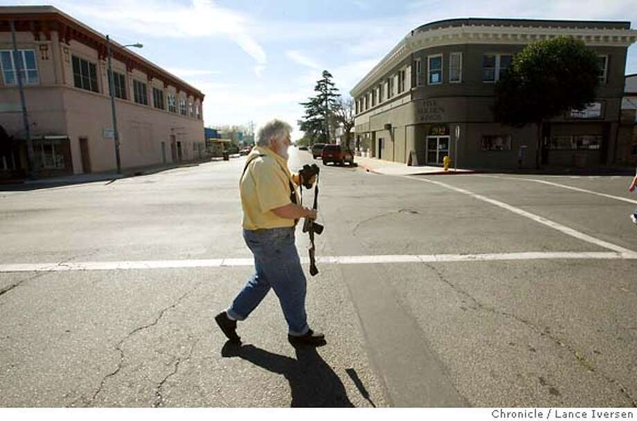 CREWS_9809.JPG  Tim Crews, Publisher and Editor of The Sacramento Valley Mirror in Willows walks from his downtown office to his next assignment at the Glenn County Jail, just hour before going to press. Crews is pretty much a one-man newspaper operation in Willows. He has turned Glenn County on its ear, exposing misuse of funds, inappropriate sexual dalliances and other corruption by such community members as the Superintendent of Schools. That investigation alone took three-years. The sometimes-hated newspaperman even went to jail a couple of years ago for refusing to give up his sources, during a trail. He continues to investigate town shenanigans or to lobby for better living conditions and health care for his readers. Next in line for his twice-weekly paper is a possible third day of publication. Now the Mirror comes out on Wednesday and Saturday mornings and sells for a dollar. March 6, 2007. WILLOWS.By Lance Iversen/The Chronicle MANDATORY CREDIT PHOTOG AND SAN FRANCISCO CHRONICLE/NO SALES MAGS OUT Photo: By Lance Iversen