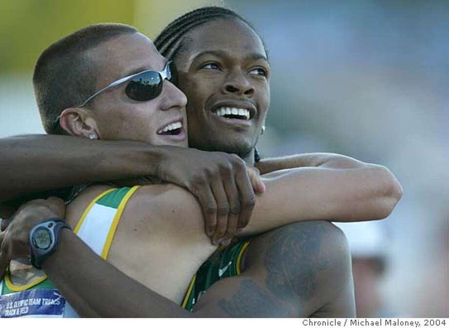 OLYTRACK16_408_MJM.jpg  Men's 400 Meters Final - Jeremy Wariner (left) and Baylor teammate Darold (cq) Williamson celebrate Warniers winning time of 44.37. Williamson came in 4th at 44.70.  U.S. Olympic Team Trials - Track and Field competition at the Alex G. Spanos Sports Complex in Sacramento.  Photo by Michael Maloney / San Francisco Chronicle Ran on: 07-16-2004  Marion Jones soars to a leap of 23 feet, 4 inches, the second-longest mark in the world this year. MANDATORY CREDIT FOR PHOTOG AND SF CHRONICLE/ -MAGS OUT Photo: Michael Maloney
