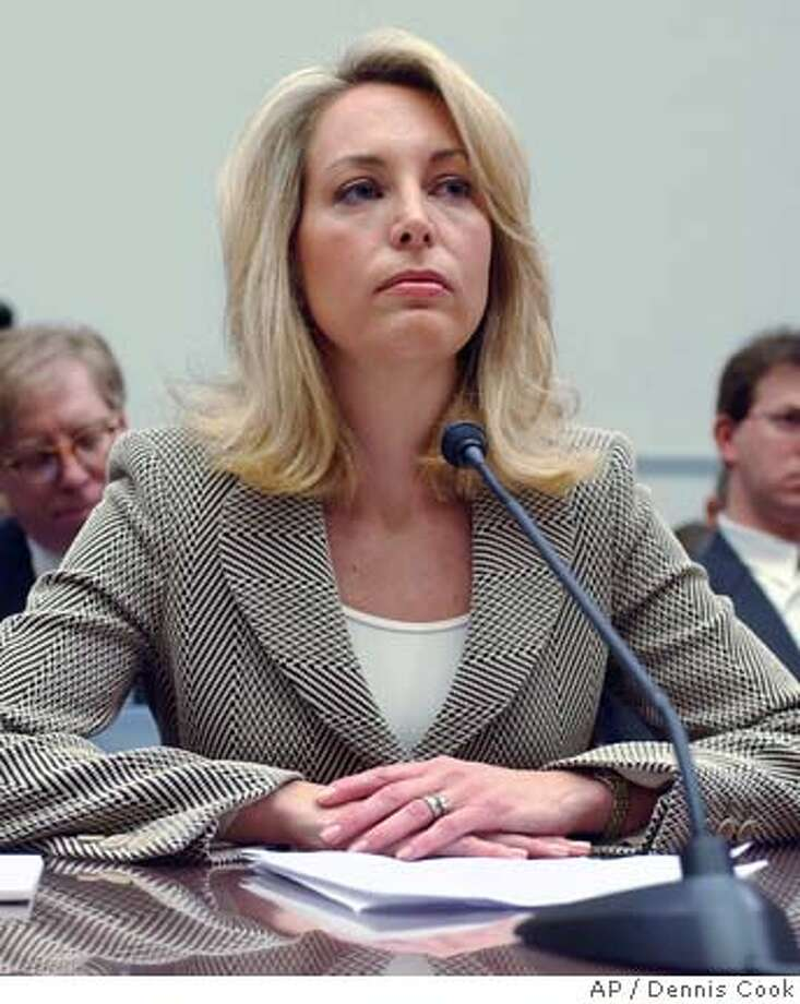 Former CIA analyst Valerie Plame listens to opening statements on Capitol Hill in Washington, Friday, March 16, 2007, during the House Oversight and Government Reform Committee. (AP Photo/Dennis Cook) Photo: Dennis Cook
