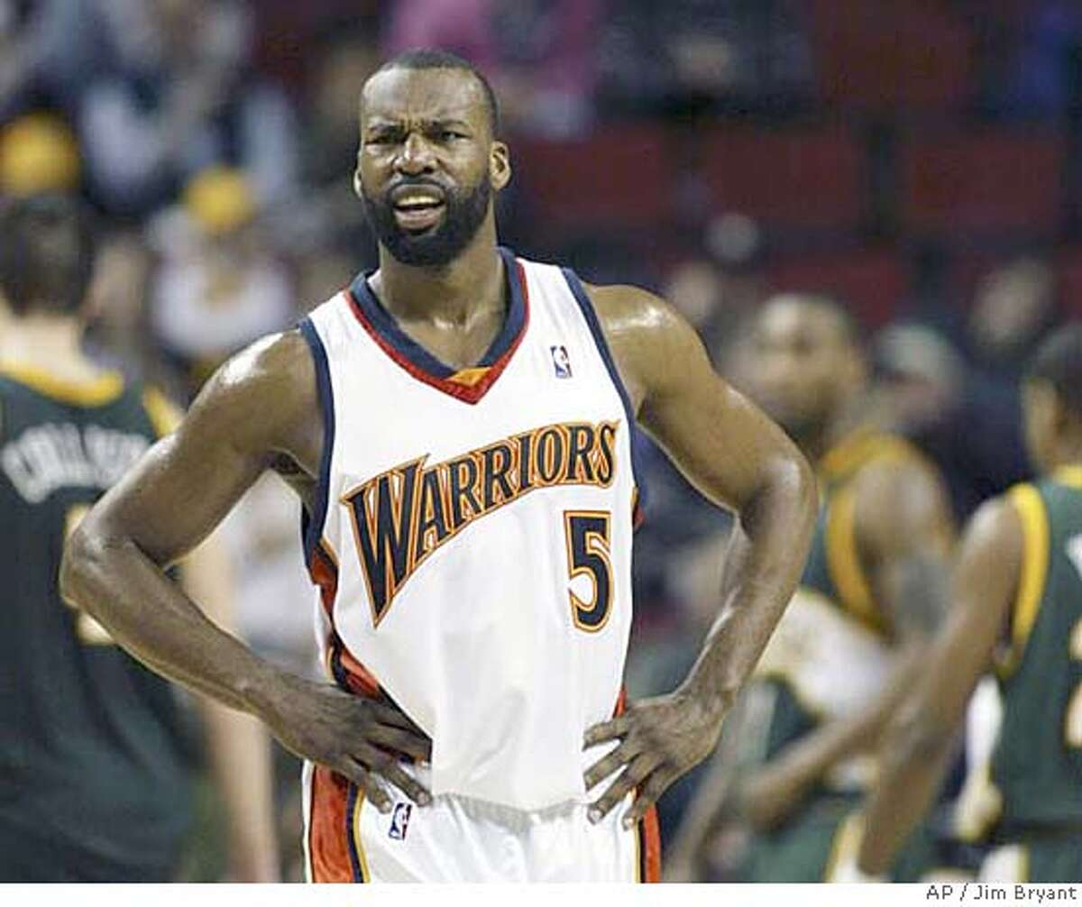 Golden State Warriors' Baron Davis stands in center court after hitting a jump shot that gave the Warriors a come-from-behind, 99-98 victory over the Seattle SuperSonics in an NBA basketball game Saturday, March 17, 2007, in Seattle. (AP Photo/Jim Bryant)