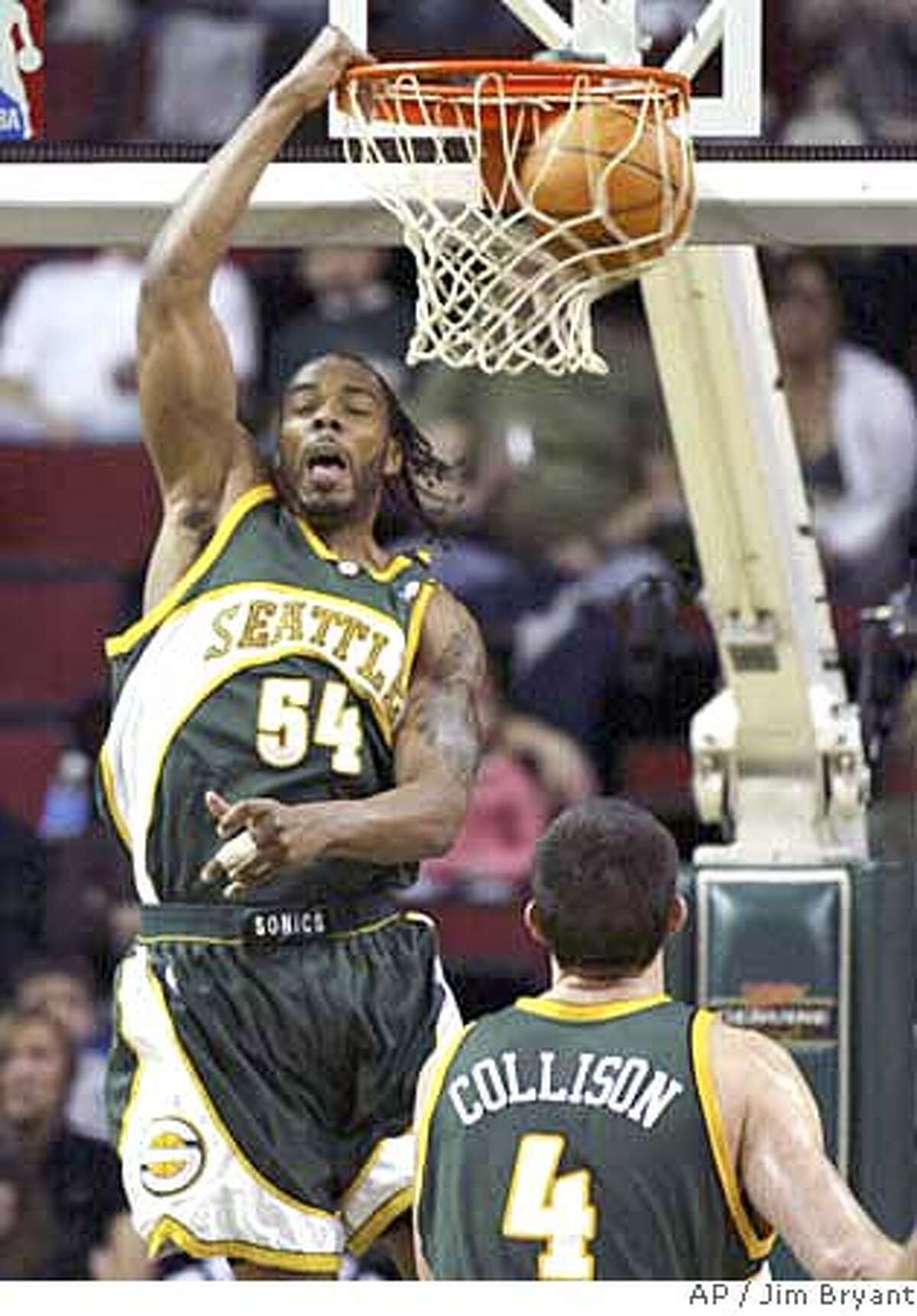 Seattle SuperSonics' Chris Wilcox dunks against the Golden State Warriors during the first half of an NBA basketball game Saturday, March 17, 2007, in Seattle. SuperSonics' Nick Collison watches. (AP Photo/Jim Bryant)