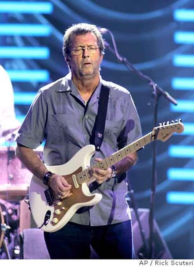 Eric Clapton performs in Phoenix on Sunday, March 11, 2007. (AP Photo/Rick Scuteri) Photo: Rick Scuteri