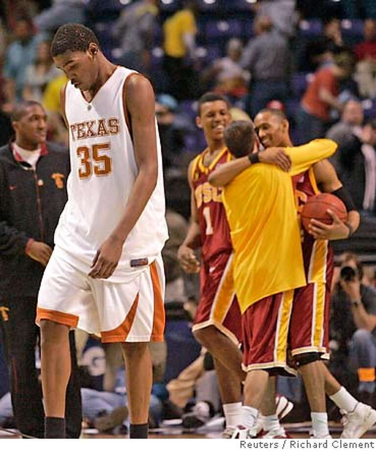 Texas freshman Kevin Durant scored 30 points but it was the USC players that were celebrating. Reuters photo by Richard Clement
