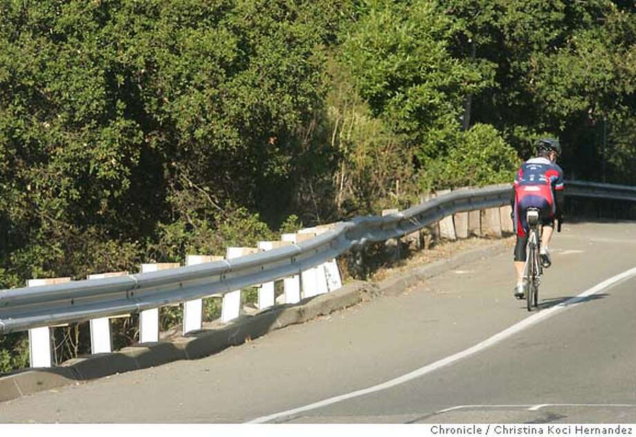 Some repairs to Castro Ranch Road in Richmond have taken place...but one dangerous curve still needs work in order to prevent injuries to bicyclists. We need some shots of the rutted lanes and shoulder near the bend in the road and guardrail on the north (left side) of Castro Ranch Road as you travel up the hill between Amend Road and Conestoga -- about 1000 feet before you get to the top of the hill. (CHRISTINA KOCI HERNANDEZ/THE CHRONICLE) Mandatory Credit For Photographer and San Francisco Chronicle/No-Sales-Mags Out Photo: Christina Koci Hernandez