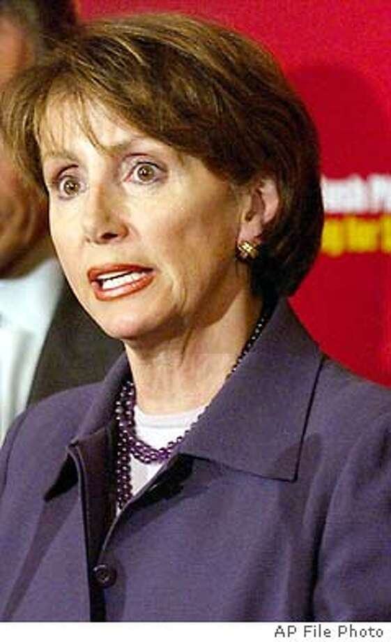 **FILE** House Minority Leader Nancy , D-Calif., shown in this Feb. 27, 2003, file photo, is among the Democrats' wealthiest members, according to financial disclosure forms released Monday, June 16, 2003. She joins another newcomer to the leadership, Senate Majority Leader Bill Frist, R-Tenn., in the Capitol Hill multimillionaire club. Senators released their disclosure forms on Friday, June 13, 2003. (AP Photo/Evan Vucci, File) Photo: EVAN VUCCI