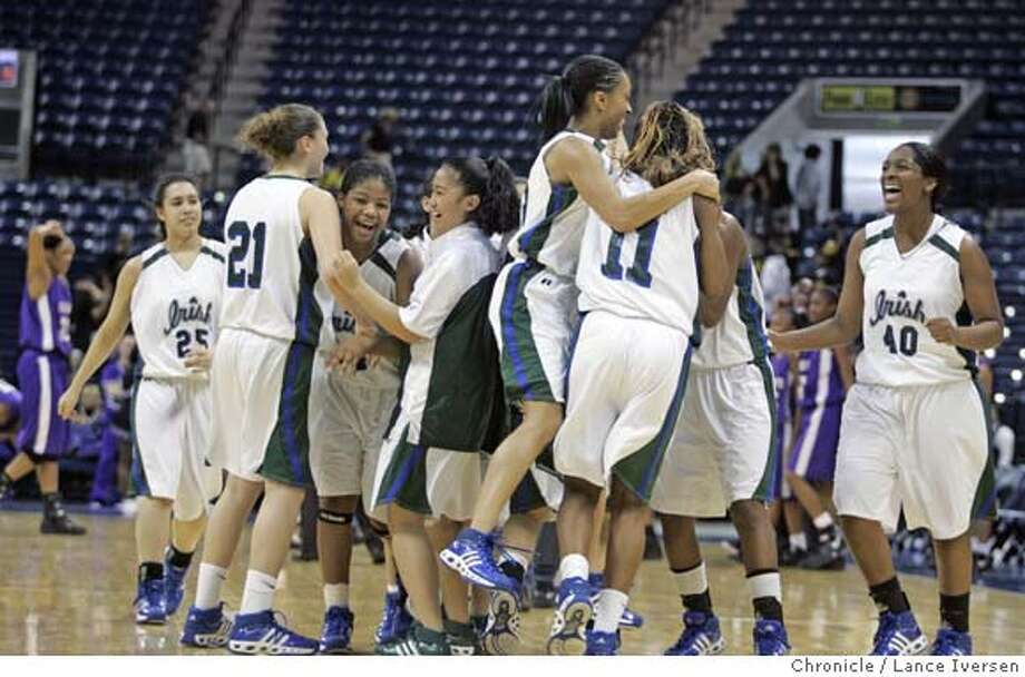 CATHEDRAL18_11607  Sacred Heart's celebrates after they defeated Sacramento 67-66. NorCal Girls Div 111 Championship. Sacred Heart Cathedral Vs. Sacramento. March 17, 2007. STOCKTON, CA By Lance Iversen/The Chronicle Ran on: 03-18-2007  Late runs by each team put the game in the balance as Sacramento's Vicki Baugh took the final shot. She missed and Sacred Heart Cathedral celebrated. Photo: Lance Iversen
