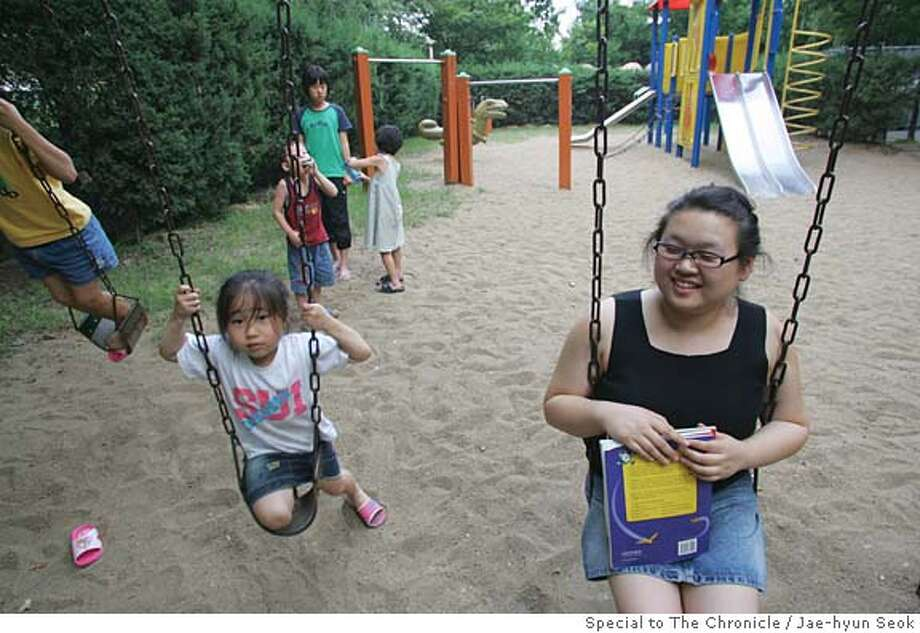 Photos to Illustrate story by Vanessa Hua, July 27, 2005. Yun Jin Carson, an adoptee who grew up in Chico and Danville, now teaches English at Oe Dea Language School in Seoul. She is in the playground for a free time in her neighbor (July 30, 2005) Photo by Jae-hyun Seok/Special to The Chronicle Photo: Jae-hyun Seok/Special To The Chr