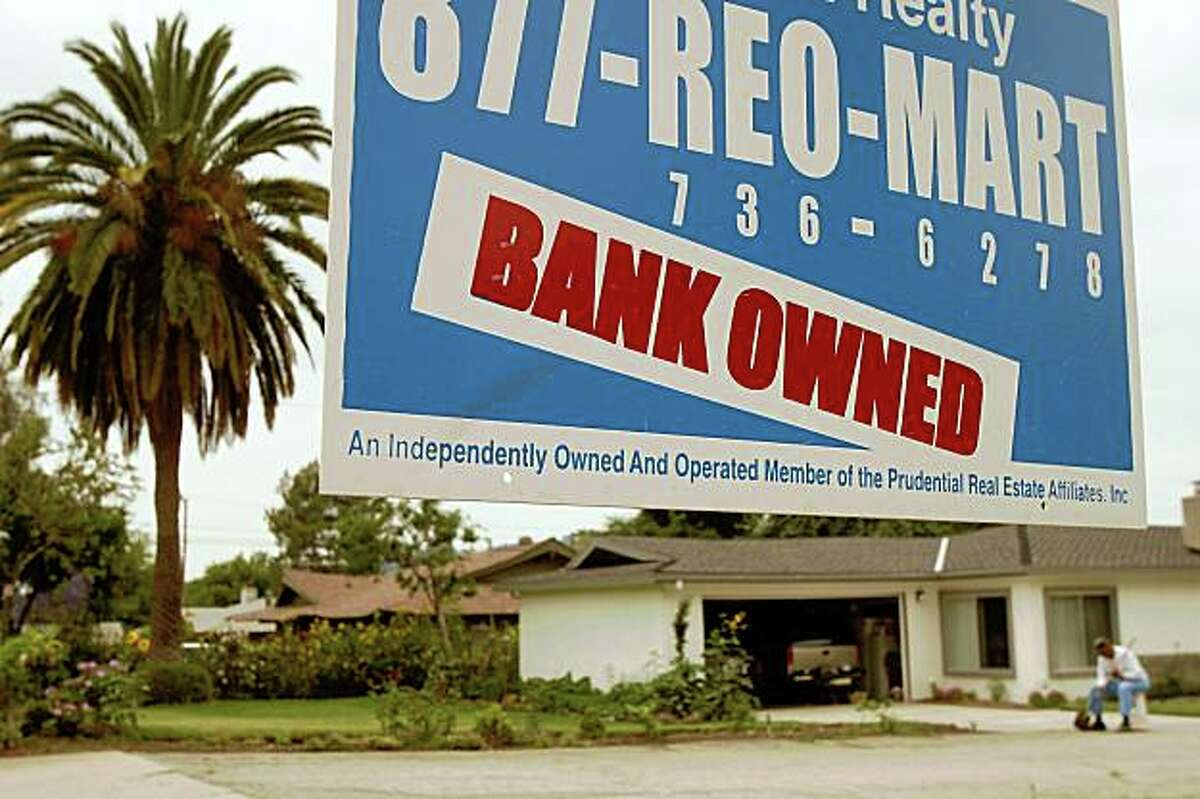 PASADENA, CA - JUNE 15: A realtor sign advertises a bank-owned house for sale as a new California law that imposes a 90-day moratorium on housing foreclosures takes effect June 15, 2009 in Pasadena, California. The California Foreclosure Prevention Act pressures lenders to work harder to keep borrowers in their homes with interest rates cuts or loans rewritten to affordable levels. Critics expect a flood of foreclosures to occur at the end of the 90-day period. Lenders have foreclosed on more than 365,000 homes California since early 2007. (Photo by David McNew/Getty Images)