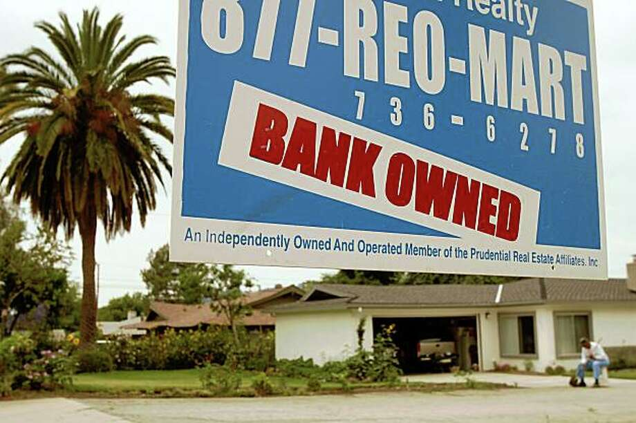 PASADENA, CA - JUNE 15:  A realtor sign advertises a bank-owned house for sale as a new California law that imposes a 90-day moratorium on housing foreclosures takes effect June 15, 2009 in Pasadena, California. The California Foreclosure Prevention Act pressures lenders to work harder to keep borrowers in their homes with interest rates cuts or loans rewritten to affordable levels. Critics expect a flood of foreclosures to occur at the end of the 90-day period. Lenders have foreclosed on more than 365,000 homes California since early 2007.   (Photo by David McNew/Getty Images) Photo: David McNew, Getty Images