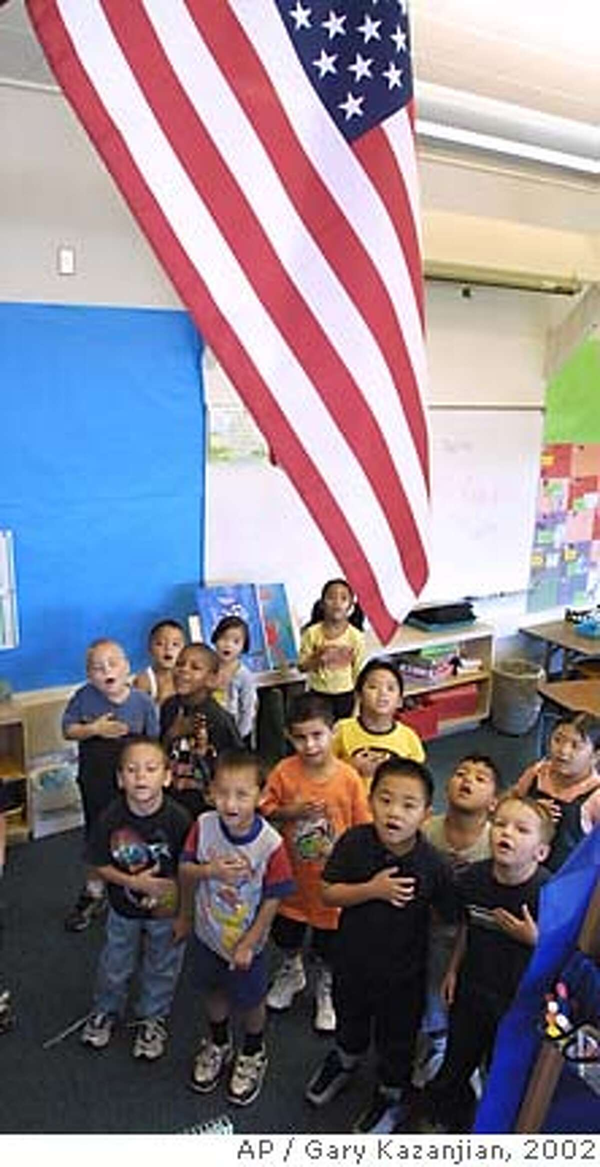 Kindergartners at Mayfair Elementary recite the Thursday, June 27, 2002 in Fresno, Calif. The Ninth Circuit Court of Appeals in California ruled Wednesday that reciting the in schools is unconstitutional, but one of the two judges who issued the ruling came out with another order that will keep the decision from taking effect, until the full appeals court can reconsider it. (AP Photo/Gary Kazanjian)