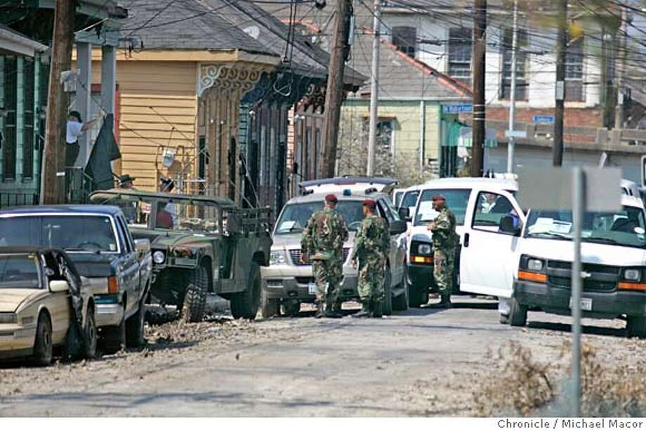 katrina12_289_mac.jpg A Coroner Team makes a stop along St. Anthony St. in the 7th Ward District of New Orleans to recover a body that has been inside a home for the past two weeks. The aftermath of Hurricane Katrina that ravaged New Orleans, Louisiana. 9/12/05 New Orleans , La Michael Macor / San Francisco Chronicle Mandatory Credit for Photographer and San Francisco Chronicle/ - Magazine Out Photo: Michael Macor
