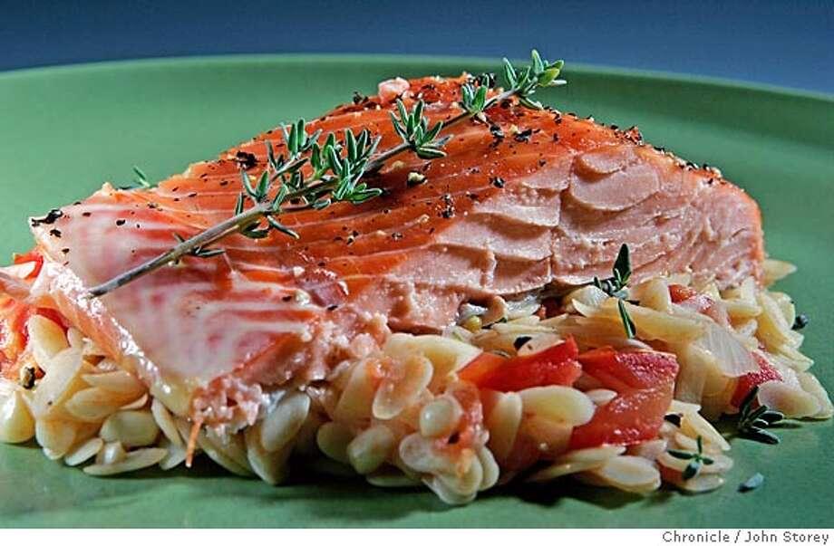 Salmon with corn tomato orzo for the working cook column.  John Storey San Francisco Event on 9/1/05  - Photo: John Storey