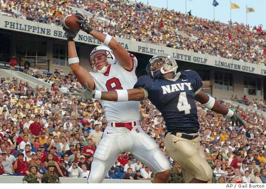 Stanford's Evan Moore catches a pass in the end zone as Navys Safety Keenan Little defends in the first quareter Saturday, Sept. 10, 2005 in Annapolis,Md.(AP Photo/Gail Burton) Photo: GAIL BURTON