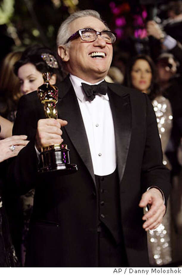 "Director Martin Scorsese laughs as he holds his Oscar for best director for his work on ""The Departed"" as he arrives at the annual Vanity Fair Oscar party at Morton's in West Hollywood, Calif., Sunday, Feb. 25, 2007. (AP Photo/Danny Moloshok) Photo: Danny Moloshok"