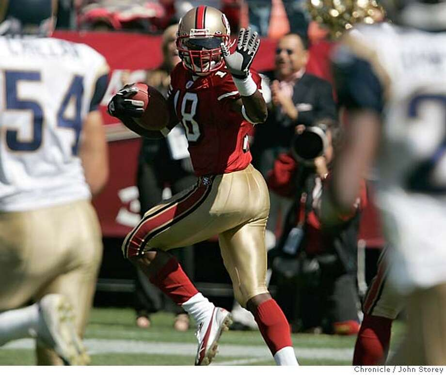 49ers_jrs_0376.jpg  49ers receiver Fred Amey waves at the Rams players on his 75 yard punt return for a touchdown. The 49ers vs. the Rams at Monster Park. John Storey San Francisco Event on 9/11/05 MANDATORY CREDIT FOR PHOTOG AND SF CHRONICLE/ -MAGS OUT Photo: John Storey
