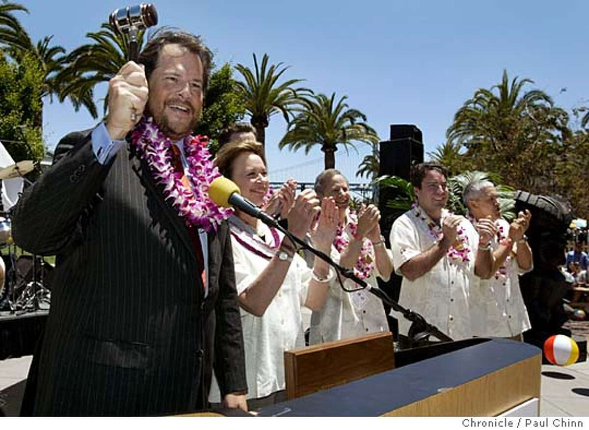 Marc Benioff (left), chairman and CEO of salesforce.com, rang the ceremonial closing bell (with a gavel) on the New York Stock Exchange at a party held at Justin Herman Plaza on 6/21/05 in San Francisco, Calif. Participating in the festivities with Benioff was NYSE president Cathy Kinney and Mayor Gavin Newsom. PAUL CHINN/The Chronicle