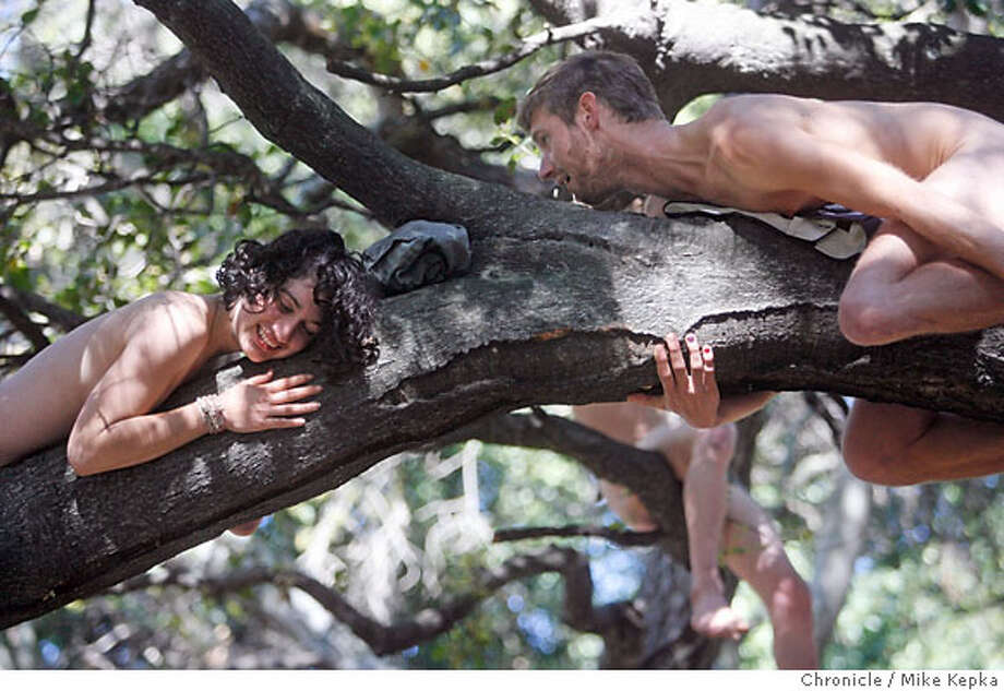 Jess Walsh and Doug Featherbeard hang naked from an oak tree they are trying to save.  In an effort to save the Oak grove next to UC Berkeley's Memorial Stadium, a group of more than 70 tree loving activists took their clothes off and posed for pictures taken by Jack Gescheidt Saturday morning.  3/17/07.  Mike Kepka / The Chronicle Jess Walsh Doug Featherbeard (cq) the source Photo: Mike Kepka