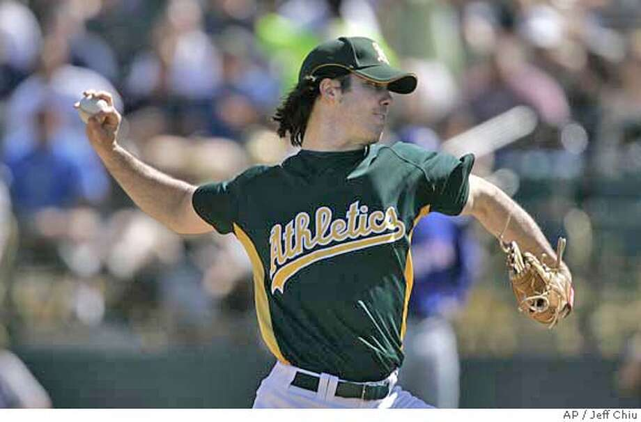 Oakland Athletics' Dan Haren pitches to the Texas Rangers in the third inning of a spring training baseball game in Phoenix, Ariz., Thursday, March 8, 2007. (AP Photo/Jeff Chiu) Photo: Jeff Chiu
