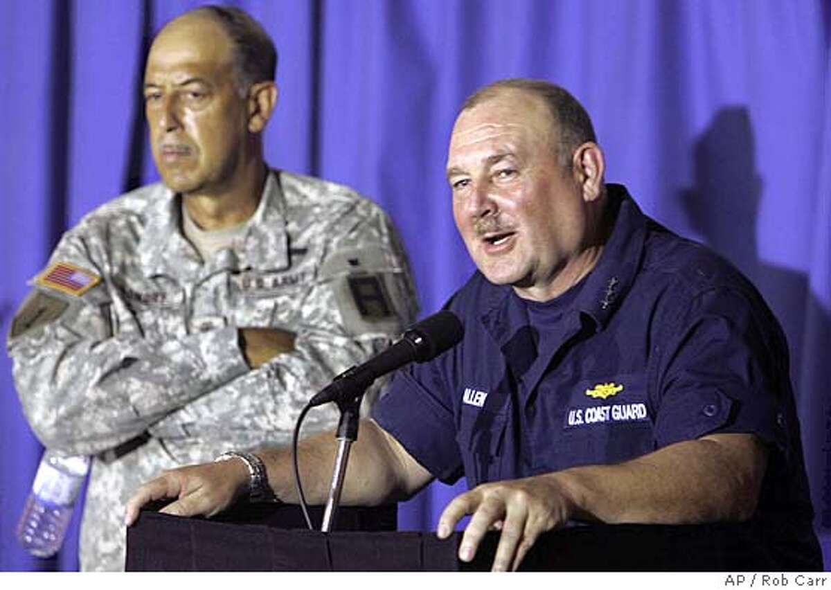 Coast Guard Vice Adm. Thad W. Allen briefs the media in Baton Rouge, La., Friday, Sept. 9, 2005, as Lt. Gen. Russel Honore watches. Federal Emergency Management Agency Director Michael Brown, the principal target of harsh criticism of the Bush administration's response to Hurricane Katrina, was relieved of his onsite command Friday and will be replaced by Allen, who was overseeing New Orleans relief, recovery and rescue efforts, Homeland Security Secretary Michael Chertoff announced. (AP Photo/Rob Carr) RETRANSMISSION FOR ALTERNATE CROP