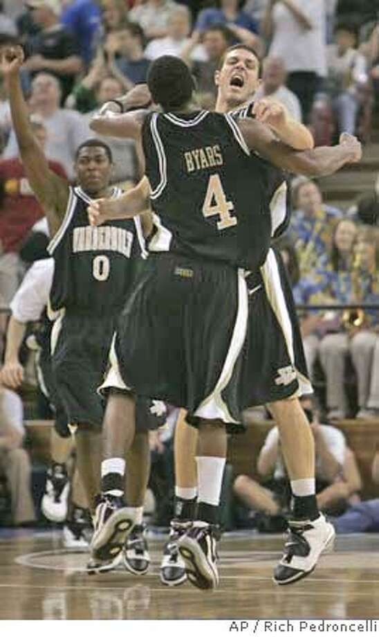 Vanderbilt's Derrick Byars, left, and Ross Neltner, leap into the air in celebration after defeating Washinton State, 78-74, in double overtime during the second round of the NCAA East Regional basketball tournament at Arco Arena in Sacramento, Calif., Saturday, March 17, 2007. (AP Photo/Rich Pedroncelli) Photo: Rich Pedroncelli