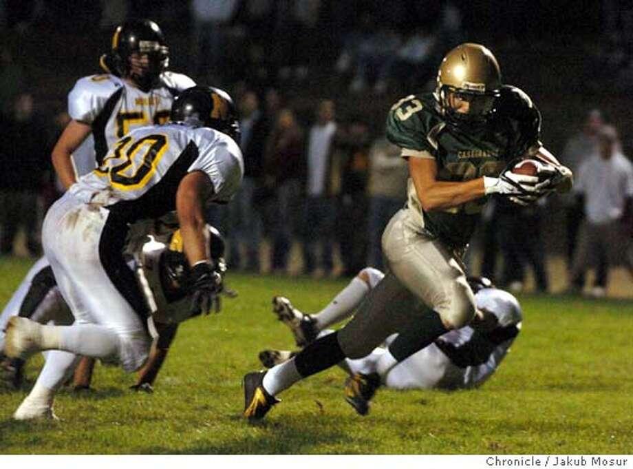 Casa Grande's Frankie Barone makes a touchdown during a game against Novato High at Casa Grande High School in Petaluma. Casa Grande beat Novato 22-19.  Event on 9/9/05 in Petaluma. JAKUB MOSUR / The Chronicle