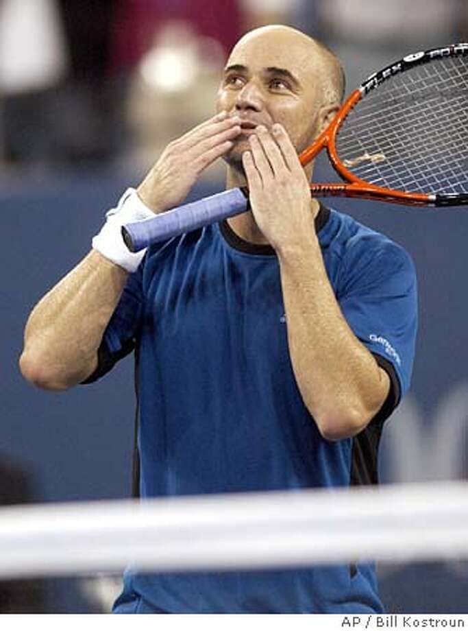 Andre Agassi of the United States blows kisses to the crowd after his match against James Blake of the United Sates at the US Open tennis tournament in New York, Wednesday Sept. 7, 2005. Agassi won the match, 3-6, 3-6, 6-3, 6-3, 7-6 (6). (AP Photo/Bill Kostroun) Photo: BILL KOSTROUN