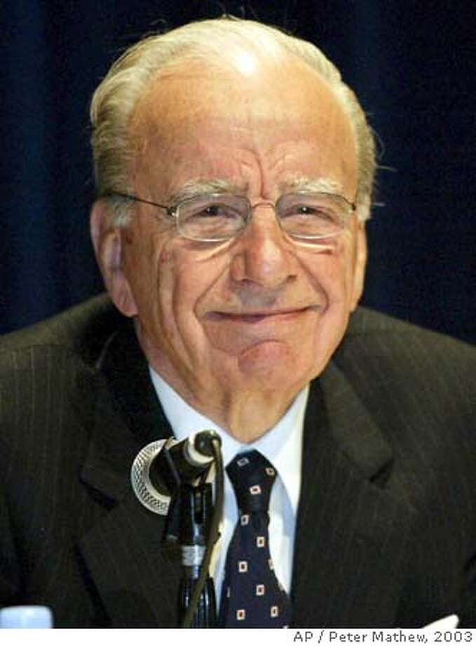 **FILE** Rupert Murdoch smiles during a press conference after the News Corporation annual general meeting in Adelaide, Australia in this Oct. 15, 2003 file photo. Murdoch's global News Corp. empire shocked Australian investors Tuesday, April 6, 2004 by announcing its shares will have a primary listing on the U.S. stock market instead of the Australian exchange by year's end. A primary listing in the United States is expected to significantly increase the international media company's shareholder baseand stimulate demand for its shares, the company said in a statement. (AP Photo/Peter Mathew, FILE) Murdoch Ran on: 01-10-2005  Rupert Murdoch Ran on: 01-10-2005  Rupert Murdoch OCT. 15, 2003 FILE PHOTO Photo: PETER MATHEW