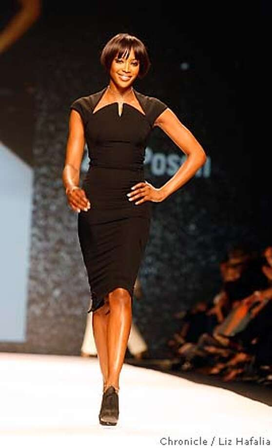 Naomi Campbell is the first model on the runway at the IMG fashion show, wearing a black sheath by Zac Posen. Chronicle photo by Liz Hafalia