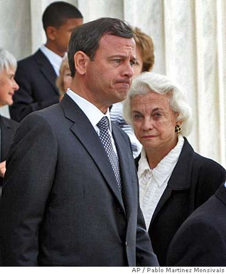 U.S. Supreme Court nominee John Roberts and pallbearer for Chief Justice William H. Rehnquist, left, walks past Associate Justice Sandra Day O'Connor as the casket bearing the body of Chief Justice William H. Rehnquist is brought to the Supreme Court, Tuesday, Sept. 6, 2005, in Washington. In the two days of ceremony honoring the nation's 16th chief justice, the casket will lie in repose at the Supreme Court where he devoted more than three decades of his life. (AP Photo/Pablo Martinez Monsivais) Photo: PABLO MARTINEZ MONSIVAIS