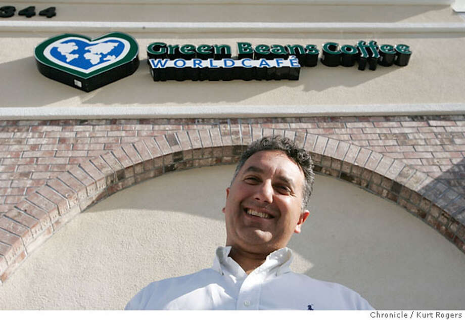 Jason Araghi the owner of Green Beans Coffee in front of the store in Fairfield Ca.  Green Beans Coffee in Fairfield is a new coffee shop that opened on monday. They started buy selling coffee to the troops in Iraq. WEDNESDAY, MARCH 07, 2007 KURT ROGERS/THE CHRONICLE FAIRFIELD THE CHRONICLE  SFC CAFE09_0022_kr.jpg  Ran on: 03-18-2007  Jason Araghi, owner of Green Beans Coffee, stands in front of the cafe in Fairfield, which opened this month.  Ran on: 03-17-2007 Photo: KURT ROGERS/THE CHRONICLE