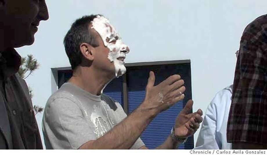PIDAY_008_CAG.TIF  Cal mathematics professor, Ken Ribet reacts after being pied after having won a contest on Pi Day on Wednesday, March 14, 2007. Ribets won the penny contest, were students put pennies in a cup and his cup had the most of all the mathematics professors. It's unofficial pi day...not pie...pi, as in 3.14... The UC Berkeley Mathematics Department undergrads are having a couple of events to celebrate March 14 ( 3-14) in the way only math majors could: 1) a Pi digit contest: who knows the most digits in pi? 2) Pi trivia contest...who knows the most about pi?  3) Pi give away...they have a fundraiser where cups with names on them have been placed in various places in the math dept. Whichever professor or graduate student instructor has the most money among the participating grad students and professors will get pied.  Photo by Carlos Avila Gonzalez/The Chronicle  Photo taken on 3/14/07, in Berkeley, Ca, USA.  **All names cq (source) MANDATORY CREDIT FOR PHOTOG AND SAN FRANCISCO CHRONICLE/NO SALES-MAGS OUT Photo: Carlos Avila Gonzalez