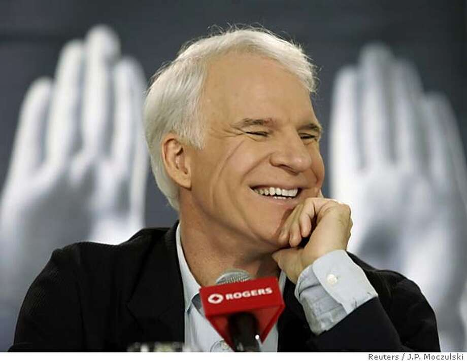 "U.S. actor Steve Martin laughs while discussing his new film ""shopgirl"" at a news conference during the Toronto International Film Festival, September 9, 2005. REUTERS/J.P. Moczulski 0 Photo: J.P. MOCZULSKI"