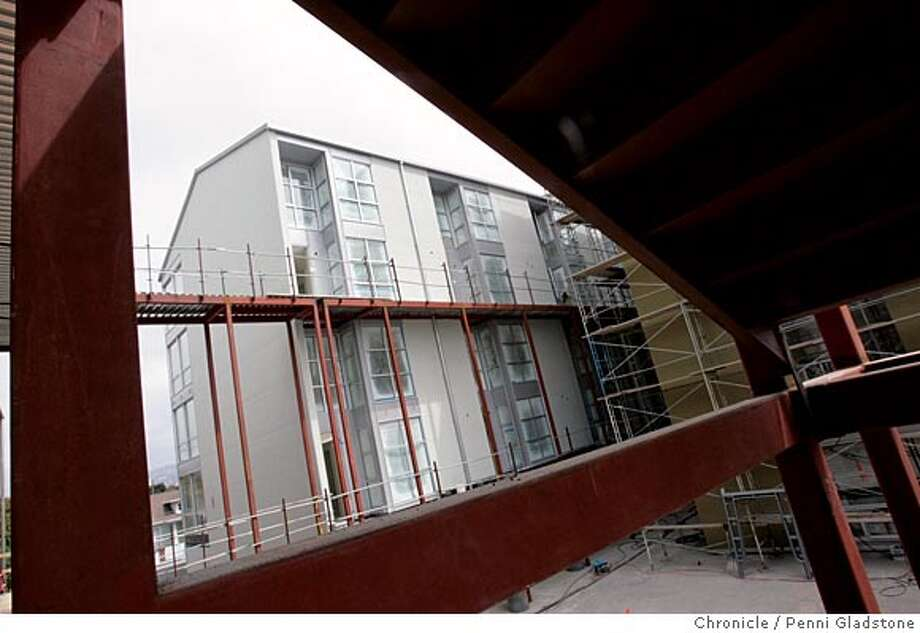 GREENCITY11_0028_PG.JPG . The cover story is on green building on a larger scale. Poster child for this is the new GreenCity lofts, in the last stages of construction on the Emeryville/Oakland border. The second part of the shoot is for the Open Homes cover. We are doing a Model Home review on one of the units, a one-bedroom, 1.5 bath townhouse  San Francisco Chronicle, Penni Gladstone  Photo taken on 9/7/05, in Oakland, Photo: Penni Gladstone