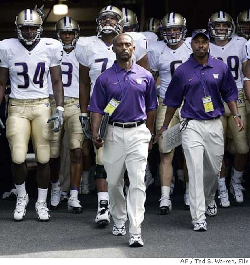 Washington head coach Tyrone Willingham, center, leads his team through the tunnel onto the field Saturday, Sept. 3, 2005 at Qwest Field in Seattle for his first game as coach of the Huskies, a game against Air Force. Wide Receiver coach Eric Yarber is at right. (AP photo/Ted S. Warren Photo: TED S. WARREN