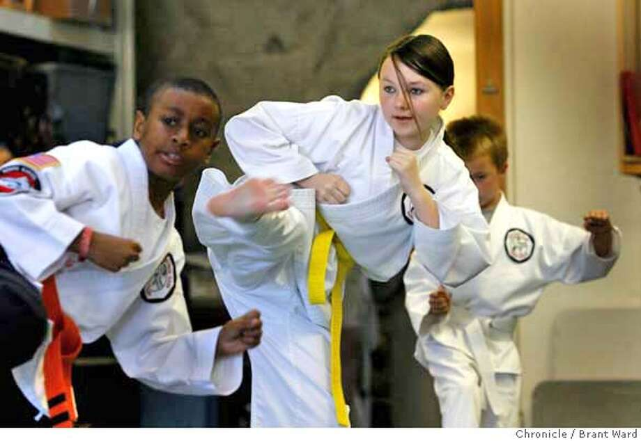 cyberbully161.JPG  Olivia Gardner goes through her karate exercises with other students.  Olivia Gardner is a 14 year old student who was subjected to attack on the internet by former classmates. Recently she has joined a karate school called Ito's White Tiger in Novato to help her protect herself. {Brant Ward/San Francisco Chronicle}3/15/07 Photo: Brant Ward
