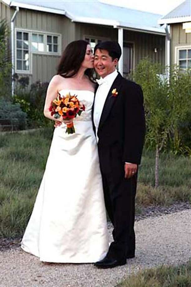 Latisha Todd and Michael Kim at their Labor Day wedding at the Carneros Inn. Credit: Angie Silvy/Special to The Chronicle Photo: Angie Silvy/Special To The Chron