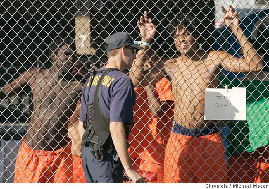"Prisoners behind the chain link fences. The Amtrak/Greyhound Terminal in downtown New Orleans, has been turned into a jail known as ""Greyhound South"". The main prison in New Orleans was damaged in the hurricane. The aftermath of Hurricane Katrina that ravaged New Orleans, Louisiana. 9/8/05 New Orleans , La Michael Macor / San Francisco Chronicle Photo: Michael Macor"